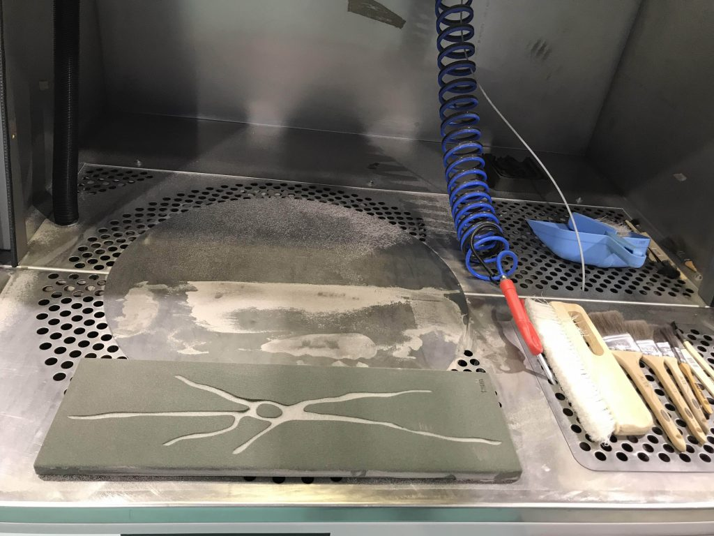 Carolynne Bourne, sand cast 'neuron' in preparation for pouring aluminium into the mould.