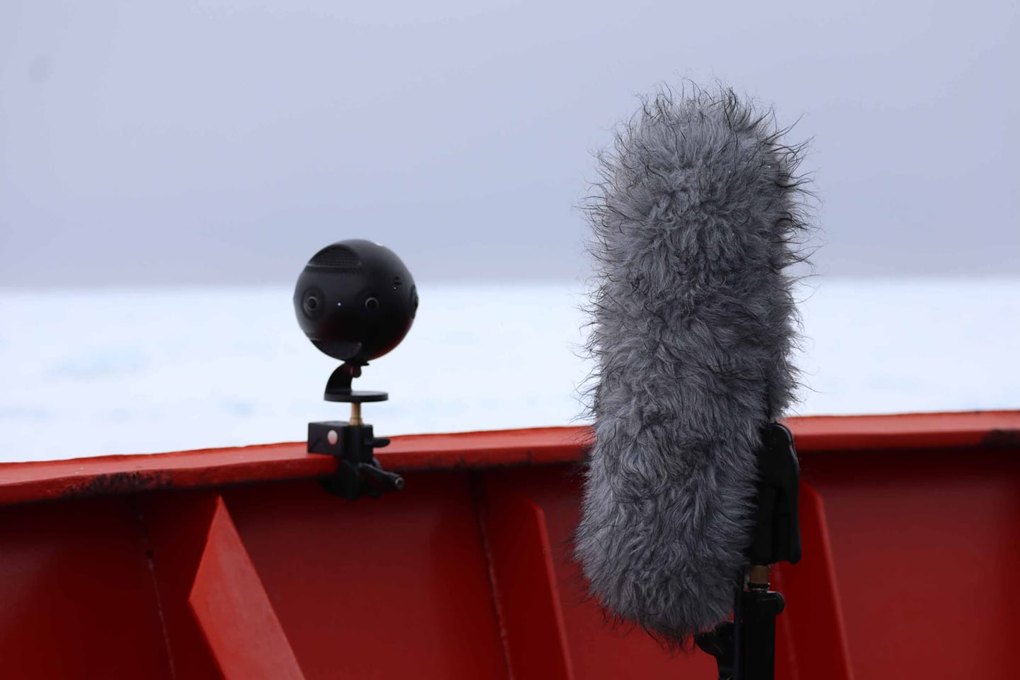 Recording the sea ice with the 360 camera and the ambisonic mic. Image courtesy Wild System, 2019-20 Australian Antarctic Arts Fellows Adam Nash and John McCormick.