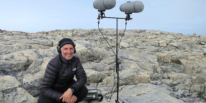 Australian Antarctic Arts Fellow, sound artist Philip Samartzis recording sounds in the field near Casey station. Photo: Philip Samartzis